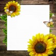 Blank paper with  yellow sunflowers on wooden background - Stok fotoğraf