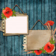 Wooden background with paper card and poppy  — Stock Photo