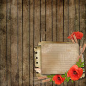 Fundo de madeira com papel cartão e papoula — Foto Stock