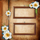 Framework for photo with spring flowers over old paper album cov — Stock Photo
