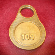 Number  written on circular golden tag — Stock Photo