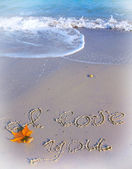 Te amo escrito en la arena de una playa — Foto de Stock