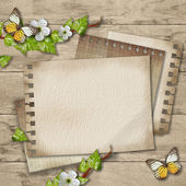 Blank paper with blossoming cherry branch and butterfly  on wood — Stock Photo