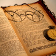 Old book, pocket watch and glasses — Stock Photo