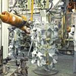 Постер, плакат: Robots in a car factory