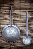 Colander and skimmer as a decoration — Stock Photo