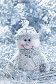 Christmas background with cheerful snowman — Stock Photo