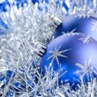 Blue christmas balls with tinsel — Stock Photo