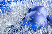 Blue christmas balls with tinsel — ストック写真