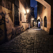 Narrow alley with lanterns in Prague at night — Stock Photo