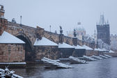 Snow Charles bridge in Prague — Stock Photo