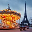 Vintage carousel close to Eiffel Tower, Paris — Stock Photo #24478549