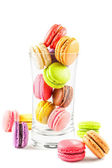 French colorful macarons in a glass — Stock Photo