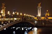 The Alexander III Bridge at night in Paris, France — Stock Photo