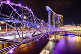 The Helix bridge with Marina Bay Sands in background — Stock Photo