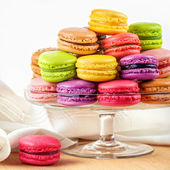 French colorful macarons in a glass cake stand — Stock Photo