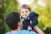 Father playing with his son, shallow DOF — Stockfoto