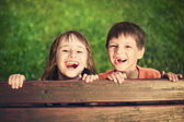 Outdoor portrait of smiling girl and boy — Stock Photo
