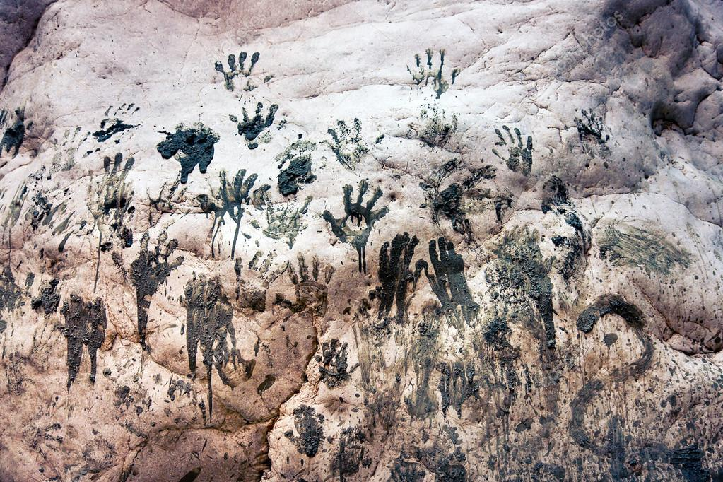 Handprints of mud on a stone wall — Stock Photo #12805277