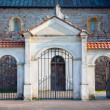 Stock Photo: Gate of Collegiate church in Tum