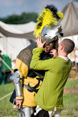 Medieval Knight removing the helmet — Stock Photo