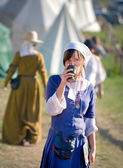Medieval fashion, middle ages woman having a drink — Stock Photo