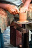 Potters Wheel, crafty hands at work — Stock Photo