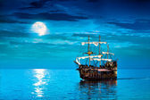 Pirate ship sailing under the full Moon — Stock Photo