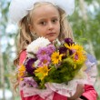 Schoolgirl dressed with a bouquet — Stock Photo
