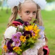 Schoolgirl dressed with a bouquet — Stockfoto