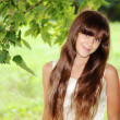 A young woman in a summer park - Stock Photo