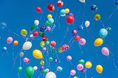 Colorful balloons on a blue sky background — Stock Photo