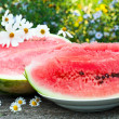 Appetizing ripe watermelon on the table — Stock Photo