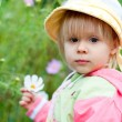 Little girl with flowers 2.5 years — Stock Photo