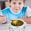 Boy eating homemade noodles — Stock Photo