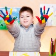 Stock Photo: Boy with hands soiled in paint