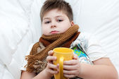Sick boy lying in bed — Stock Photo