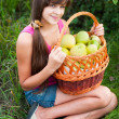 Teen girl with a basket of apples — Stock Photo #16217835