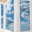 Plastic window with a beautiful sky — Stock Photo