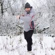 A man goes in for sports in winter outdoors — Stock Photo