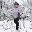 A man goes in for sports in winter outdoors — Stock Photo #18700109