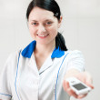 Woman doctor hands mobile phone — Stock Photo