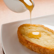 Delicious toast with honey — Stock Photo