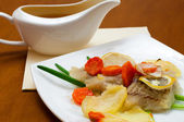Cod baked with vegetables — Stock Photo