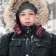 Portrait of a boy in winter clothes during snowfall — Foto de Stock