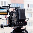 Professional video camera on a city street — Stock Photo