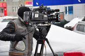 A professional videographer at work — Stock Photo