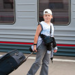Boy with travel bag near the train — Stock Photo