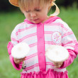 Stock Photo: Little girl with white mushrooms