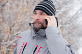 Man talking on the phone in the park — Stock Photo